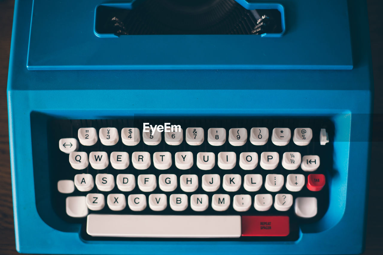High Angle View Of Blue Typewriter