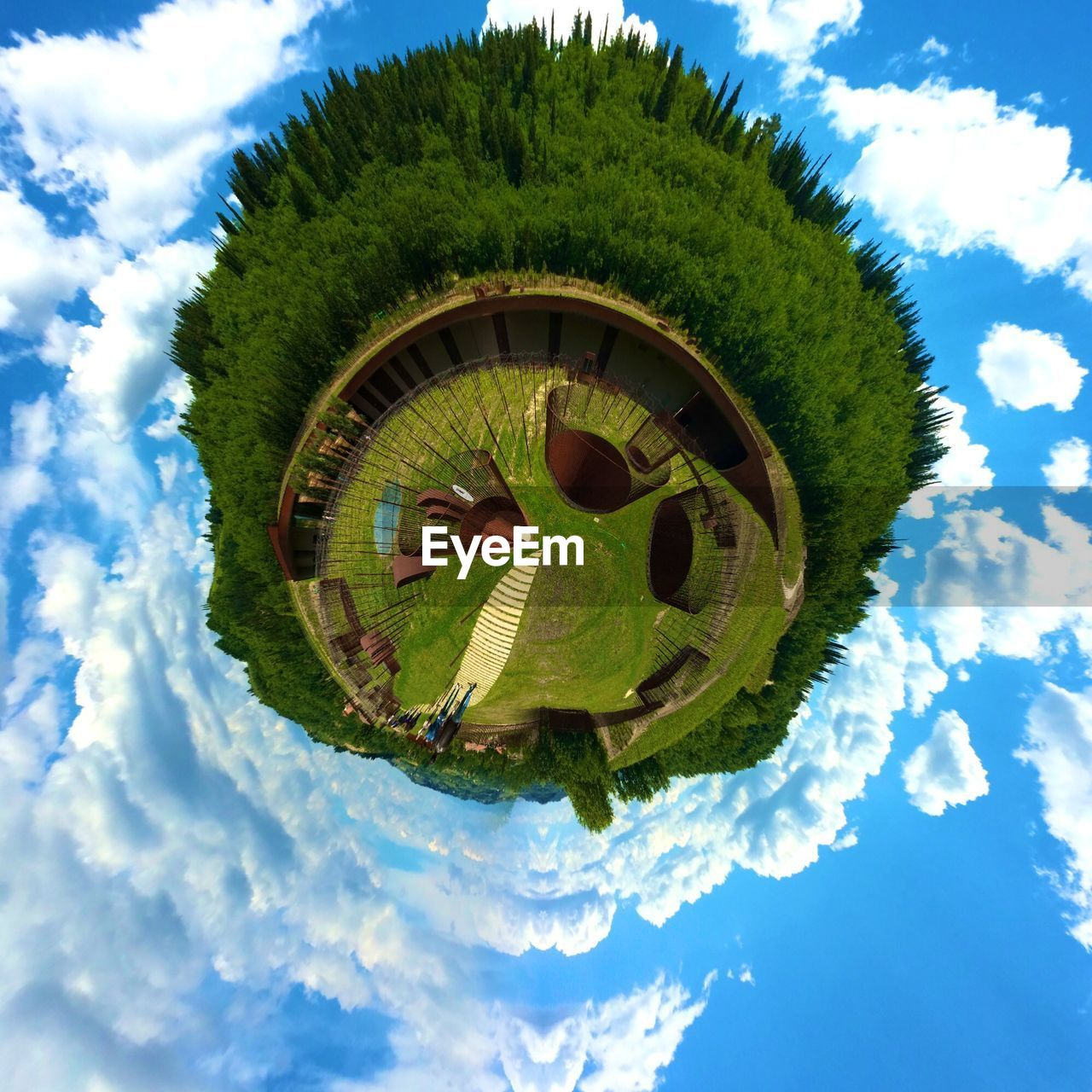 Little Planet Effect Of Park And Buildings Against Sky