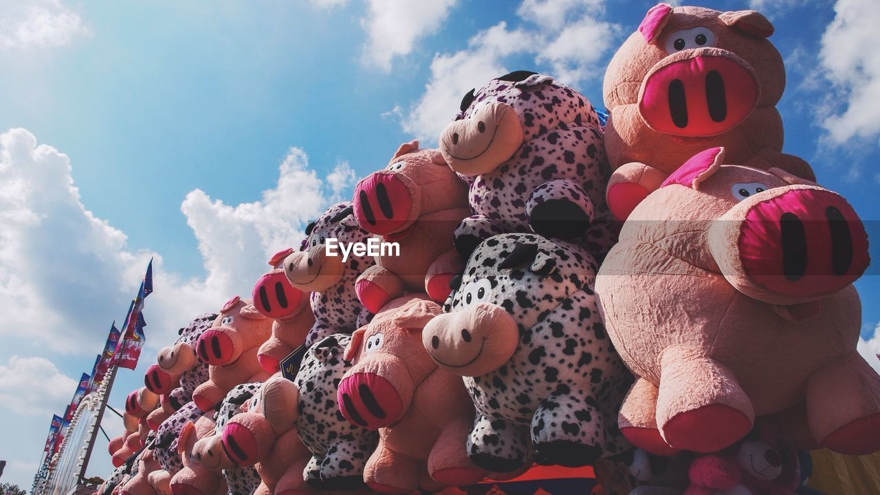 Low Angle View Of Stuffed Toys Against Sky