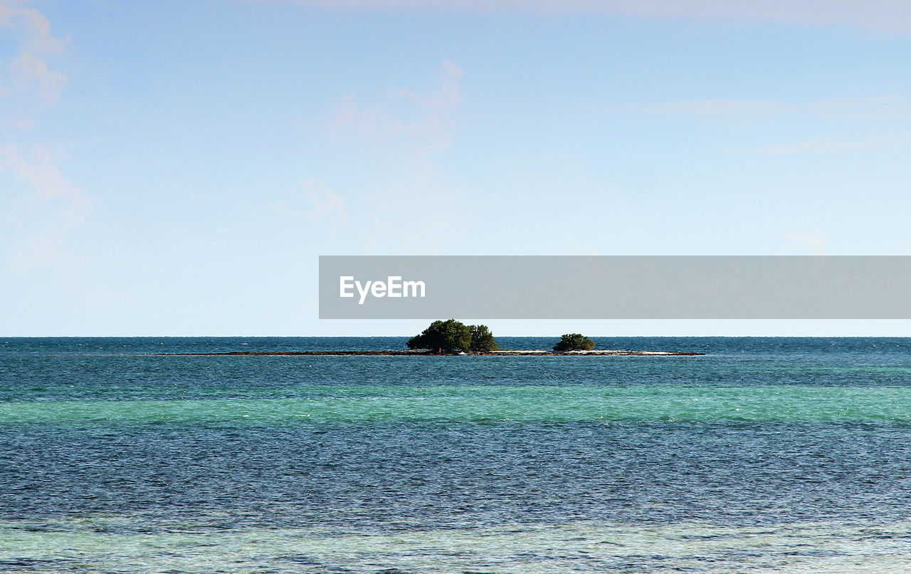sea, horizon over water, tranquil scene, scenics, tranquility, water, beauty in nature, nature, idyllic, waterfront, clear sky, sky, rippled, outdoors, day, no people, blue