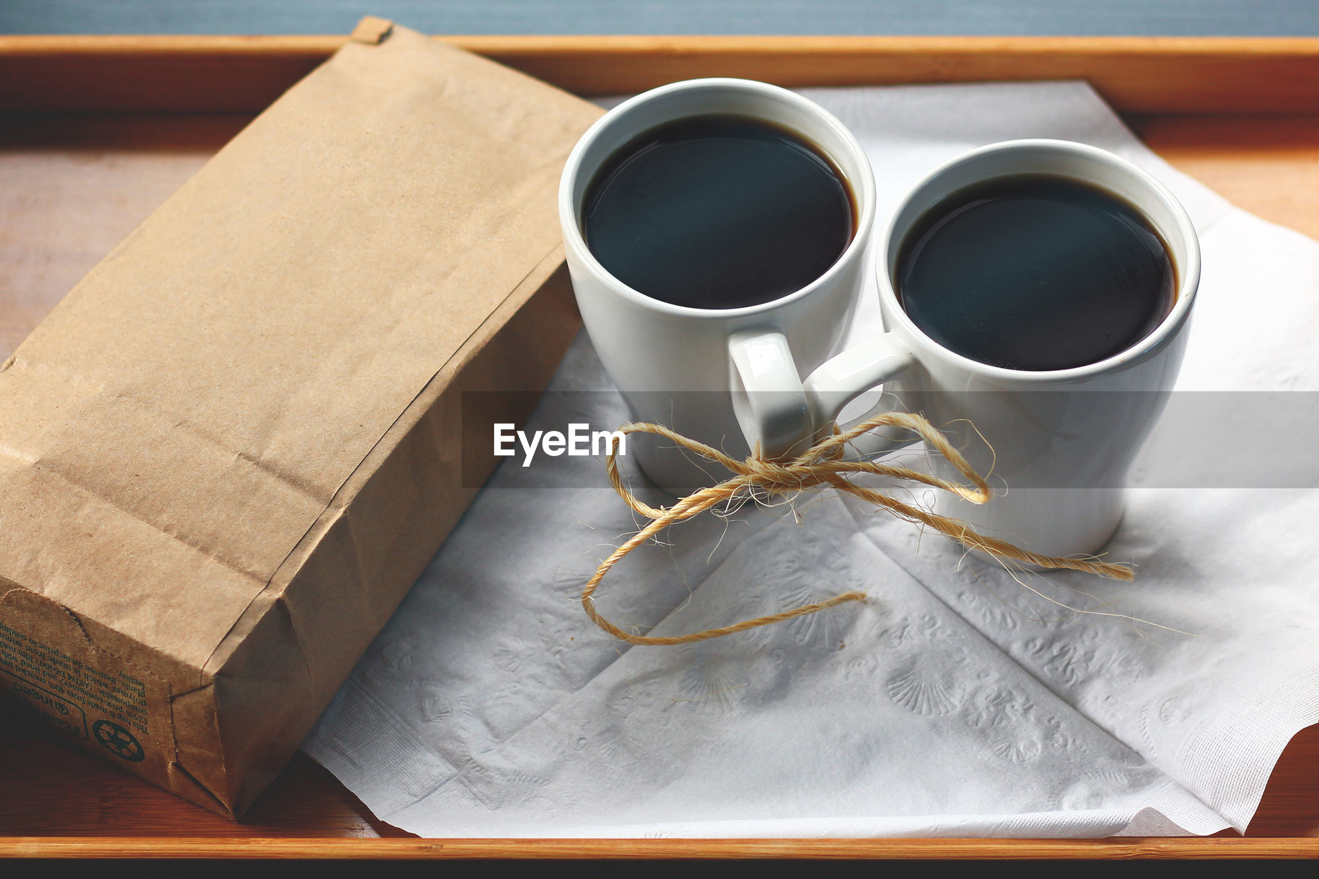 High angle view of black coffee in cups on table