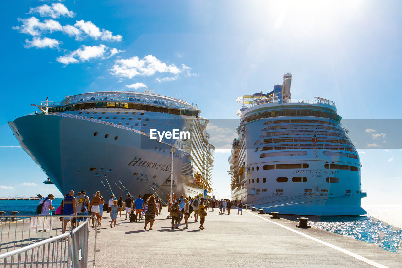sky, group of people, sunlight, nature, real people, ship, men, day, large group of people, sea, water, cloud - sky, crowd, travel, leisure activity, architecture, nautical vessel, built structure, outdoors, cruise ship