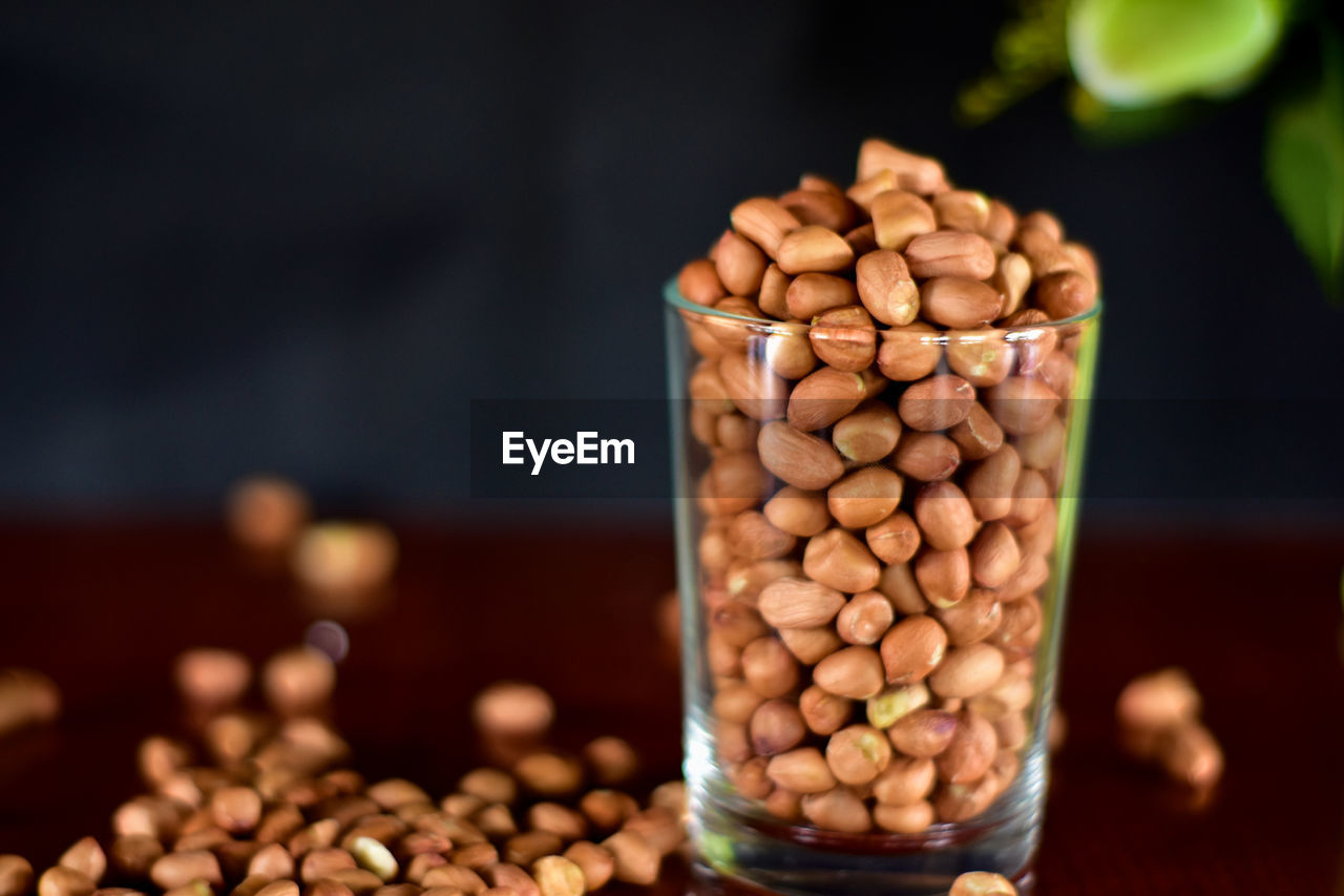 food and drink, food, still life, large group of objects, freshness, indoors, selective focus, close-up, table, abundance, brown, no people, focus on foreground, roasted coffee bean, container, coffee - drink, coffee, coffee bean, wellbeing, nut, caffeine, temptation