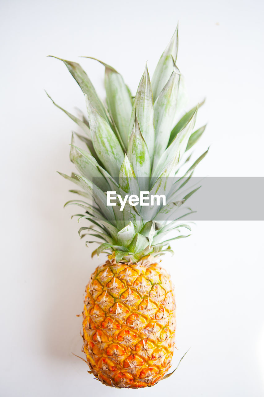 healthy eating, studio shot, fruit, food, food and drink, indoors, white background, pineapple, freshness, wellbeing, still life, tropical fruit, close-up, orange color, no people, green color, single object, orange, plant part, leaf, lychee