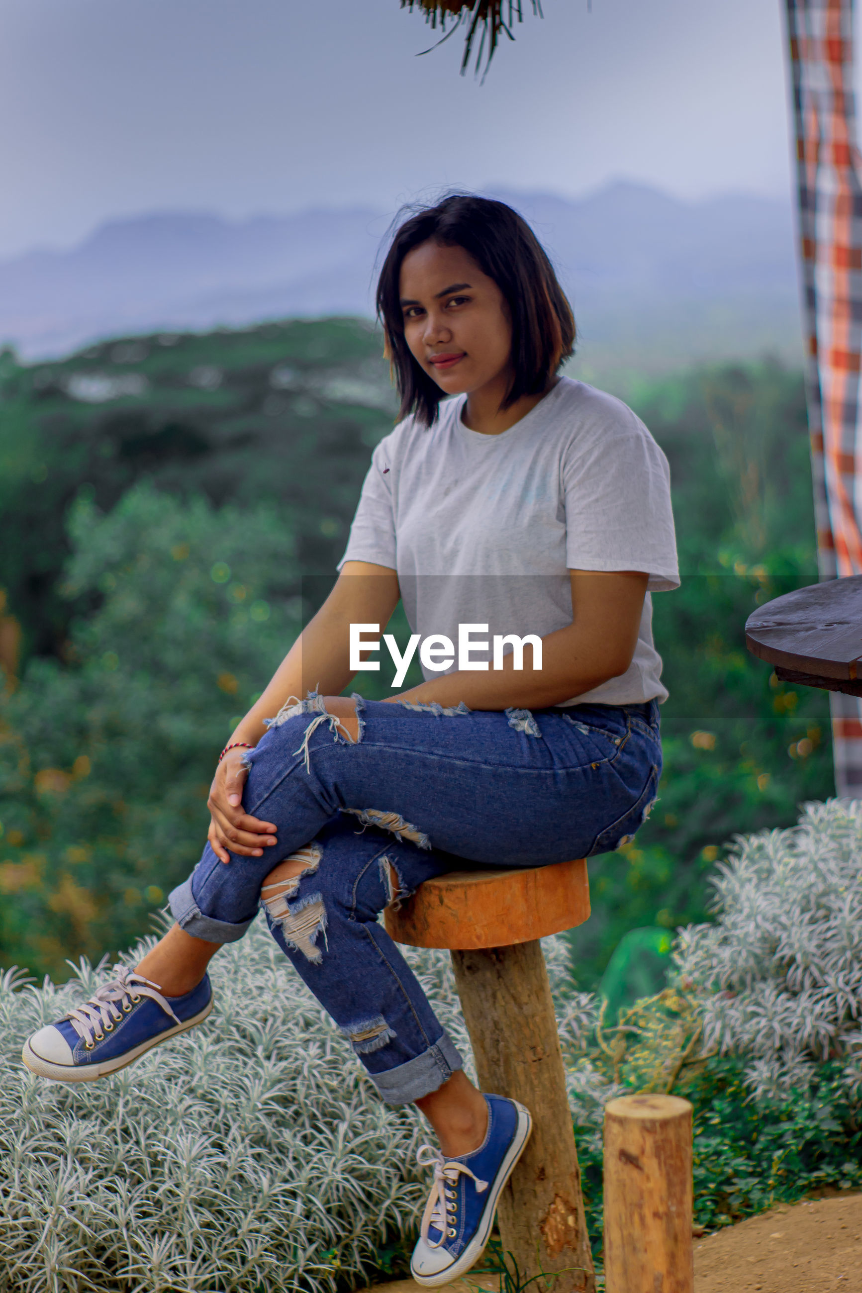 smile woman in garden Woman Portrait Woman Who Inspire You Women Of EyeEm Women Full Length Sitting Portrait Smiling Black Hair Jeans Beautiful Woman Casual Clothing Prepared Food Grassland Growing Gardening Glove