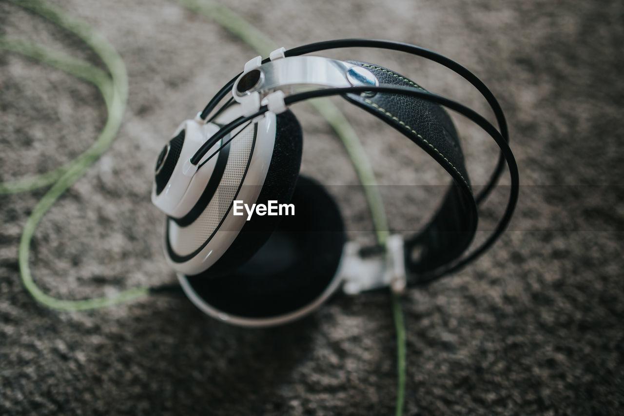 Close-up of headphones on rock