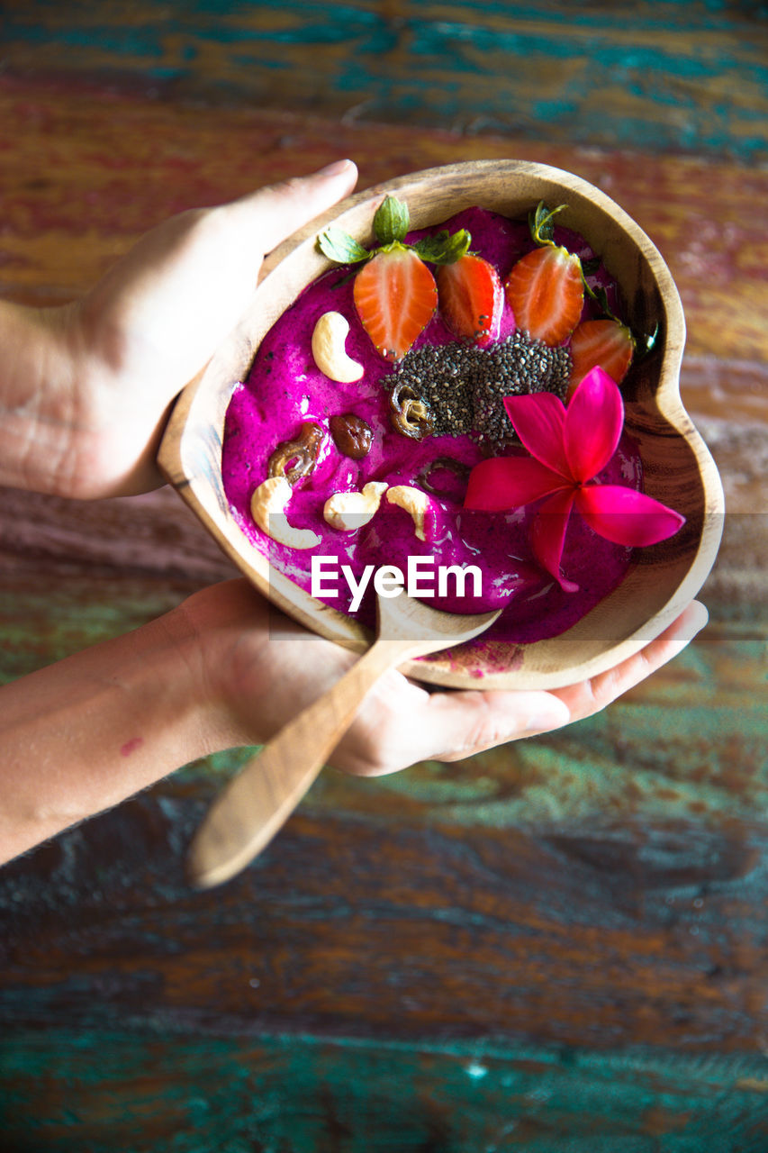 human hand, human body part, freshness, one person, food and drink, real people, holding, food, healthy eating, lifestyles, table, fruit, women, close-up, dessert, indoors, healthy lifestyle, nature, day, flower, ready-to-eat, people