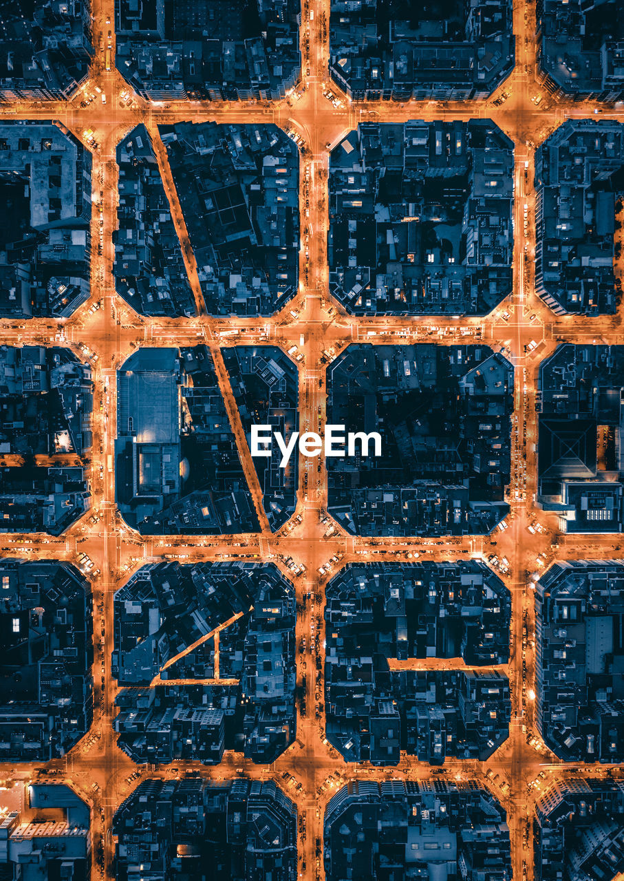 High angle aerial view of city blocks of barcelona at night
