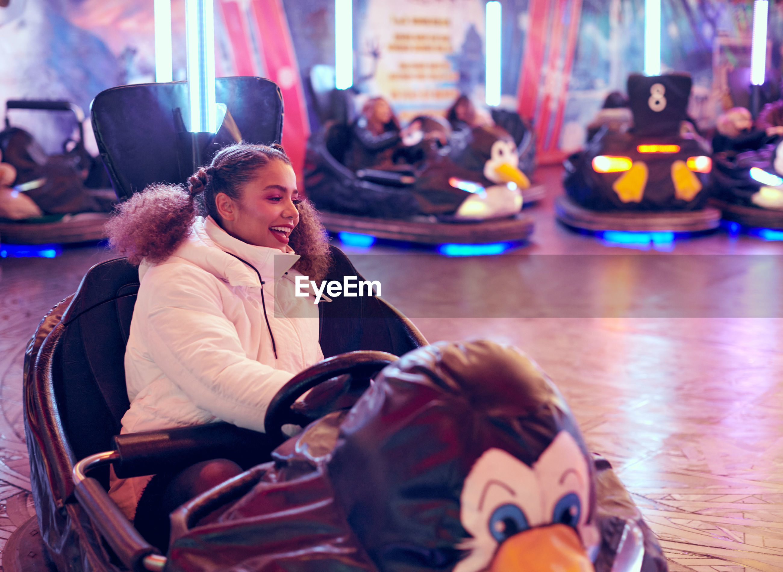 Happy woman playing in amusement park