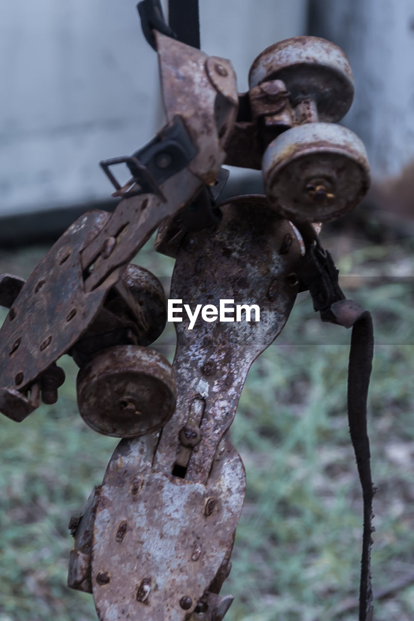 focus on foreground, close-up, metal, no people, outdoors, rusty, day