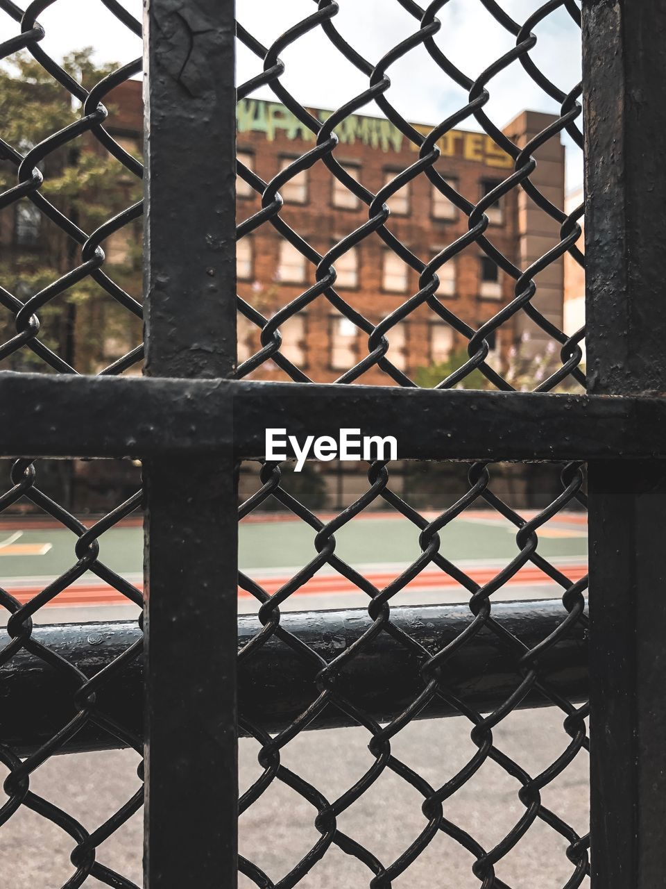 CLOSE-UP OF CHAINLINK FENCE WITH GATE