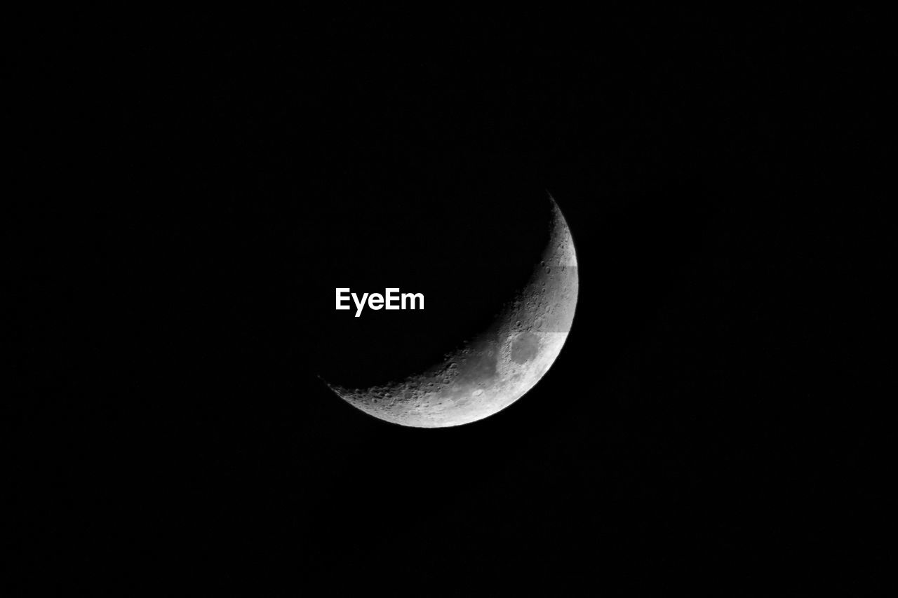 LOW ANGLE VIEW OF HALF MOON IN SKY