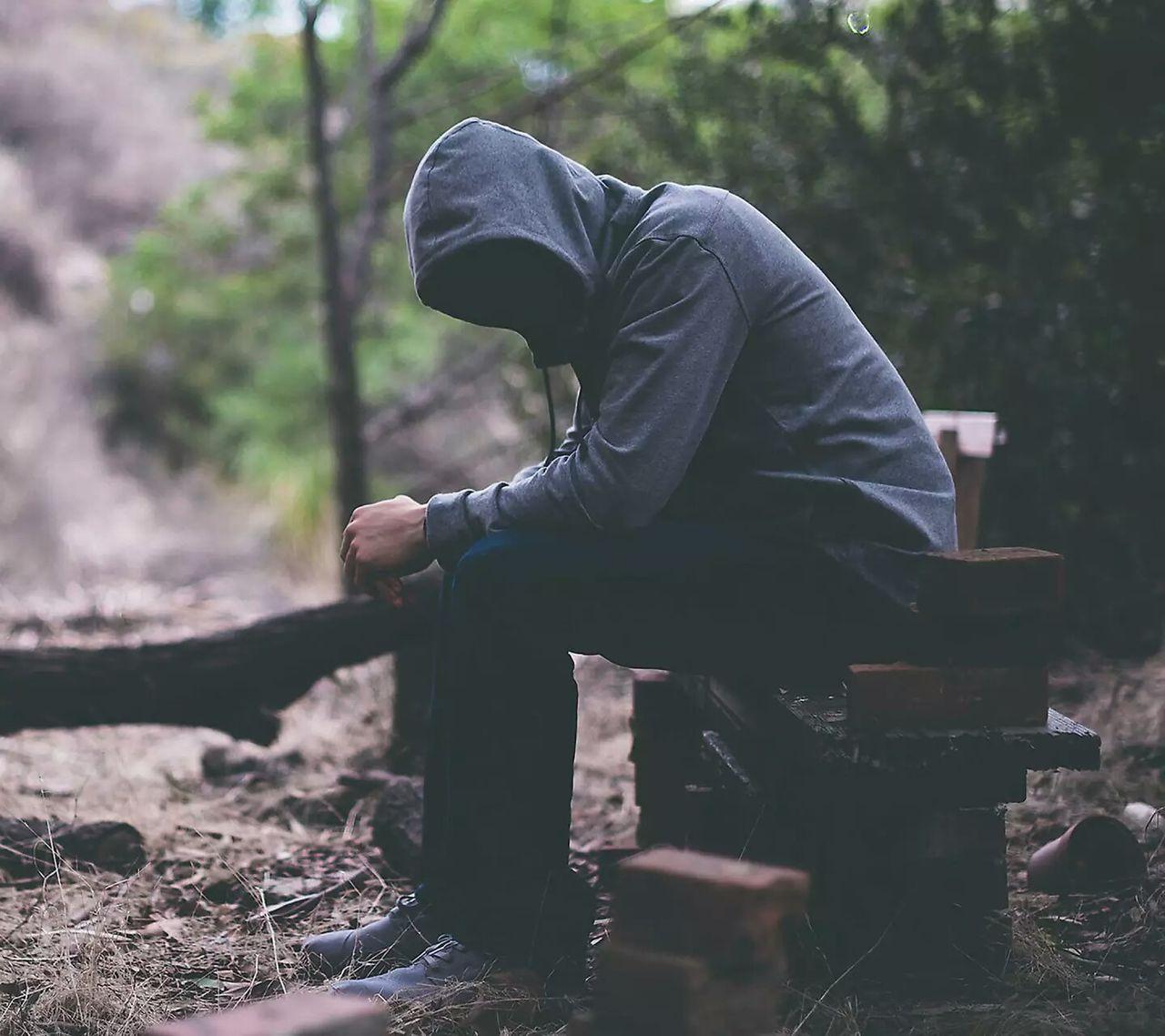 Full length of man sitting outdoors