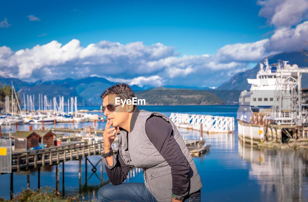 Side View Of Man Standing Against Sea