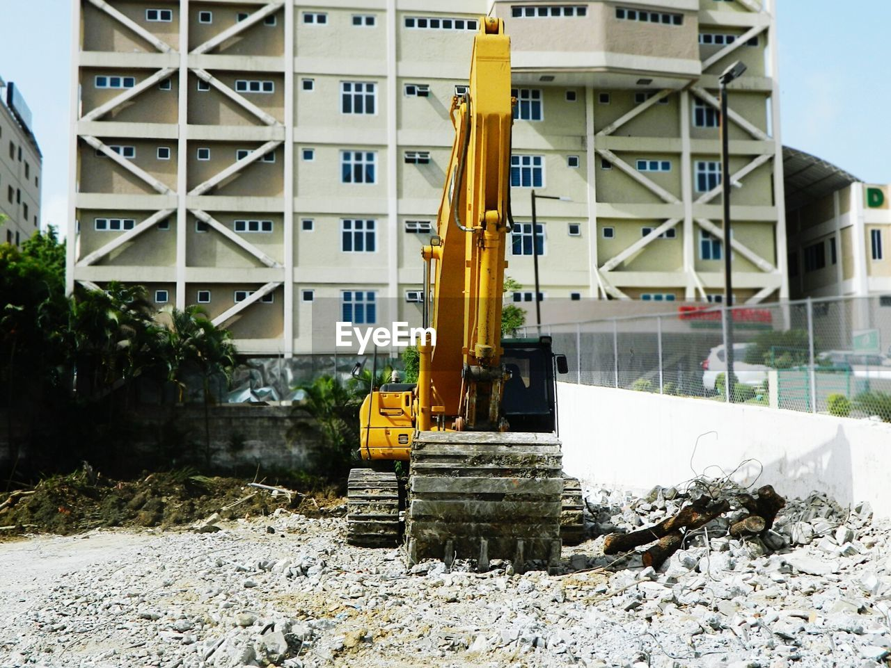View of dump truck on construction site by building