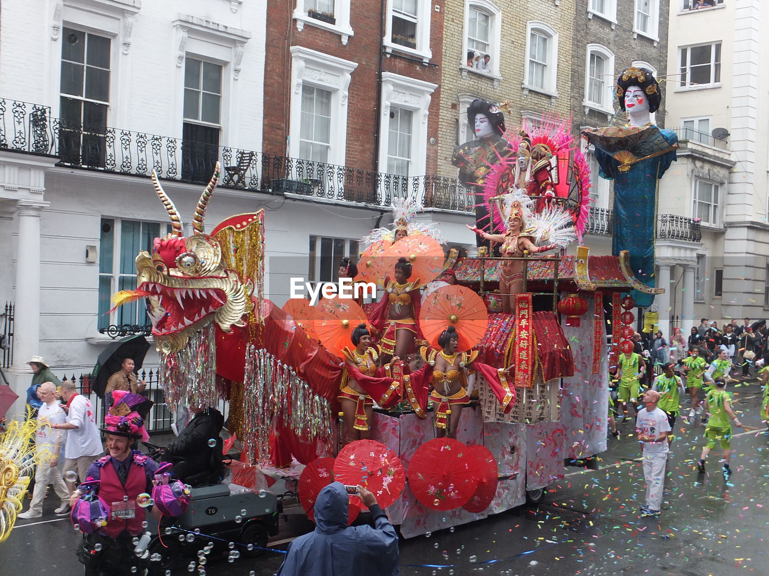 People on street against buildings at notting hill carnival