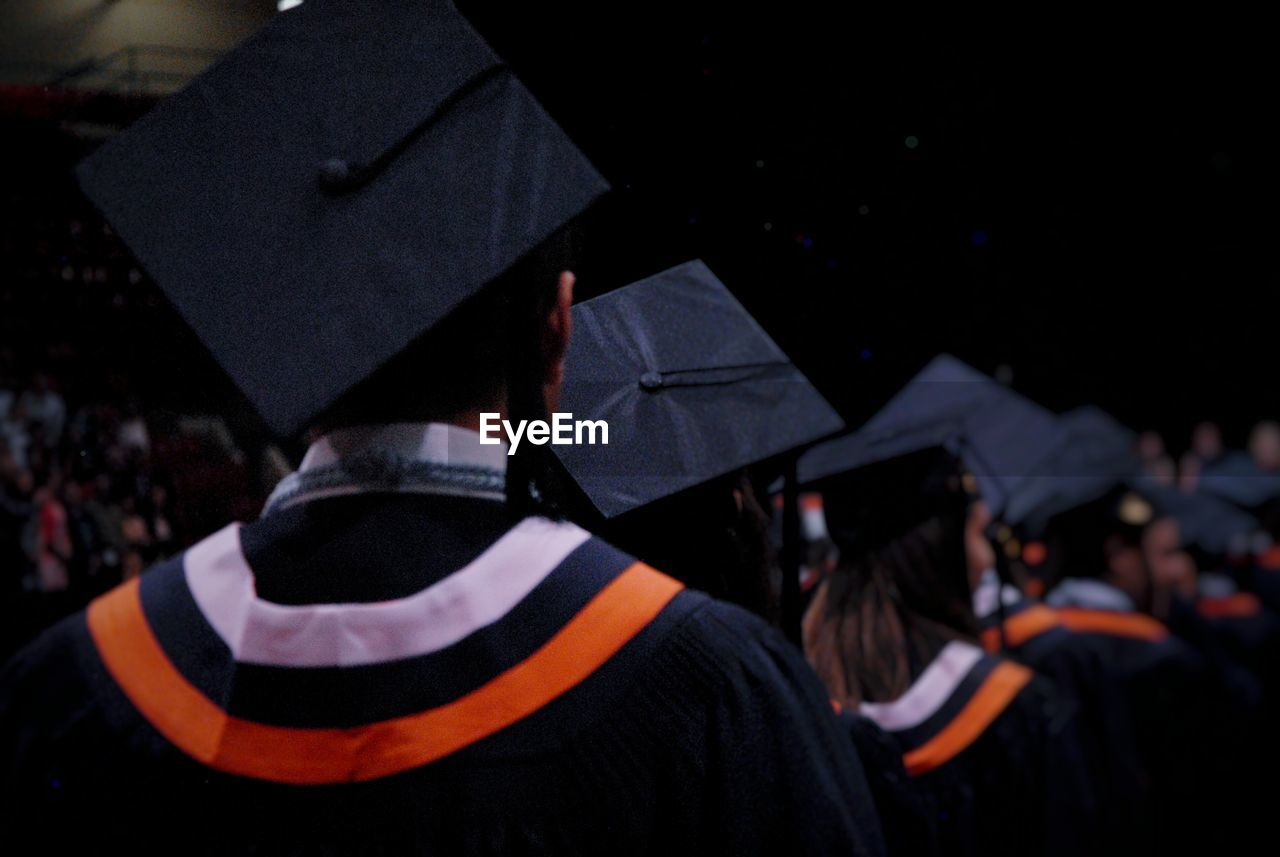 Rear View Of Students At Graduation Ceremony