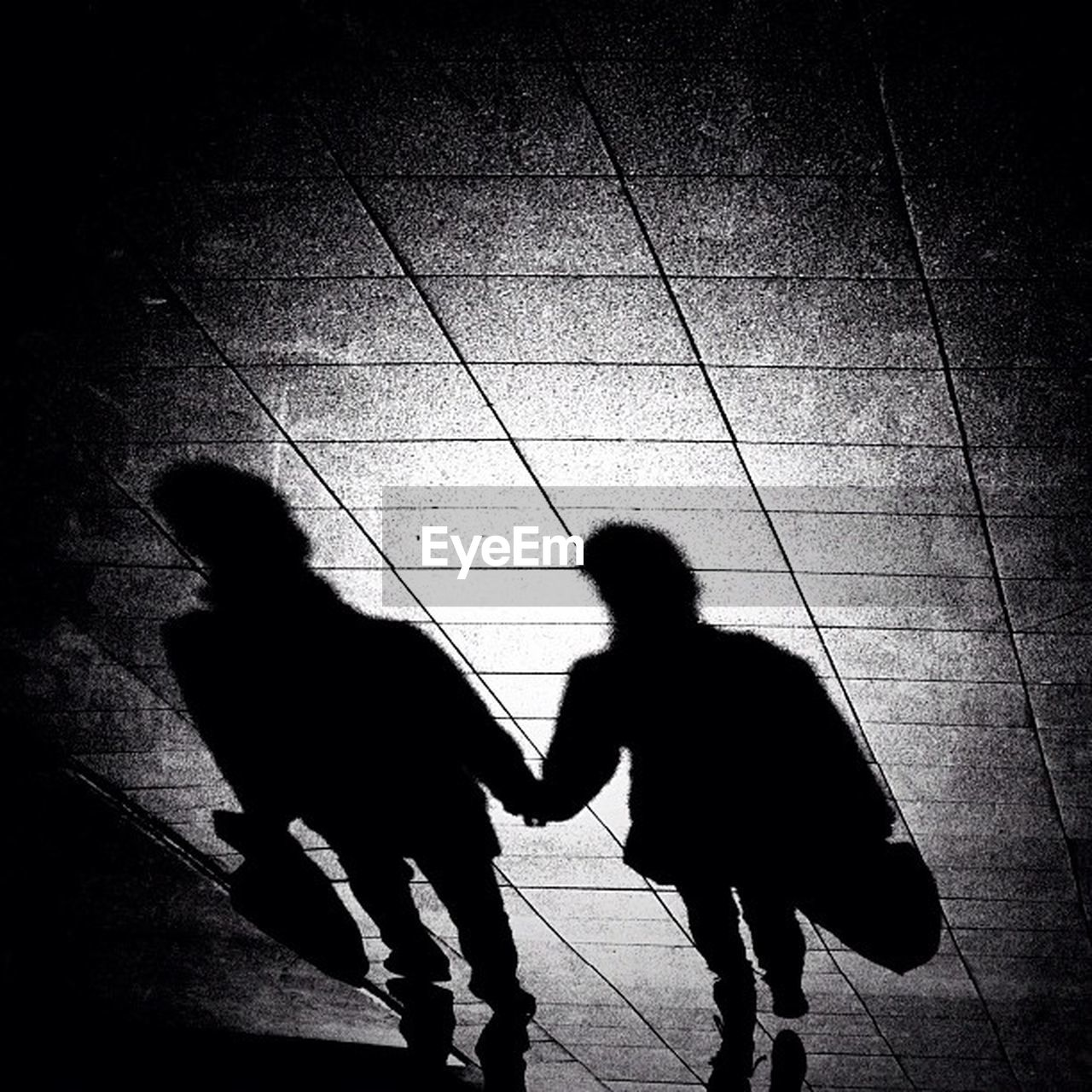 full length, childhood, two people, walking, togetherness, silhouette, real people, shadow, boys, girls, standing, indoors, day, child, men, bonding, people