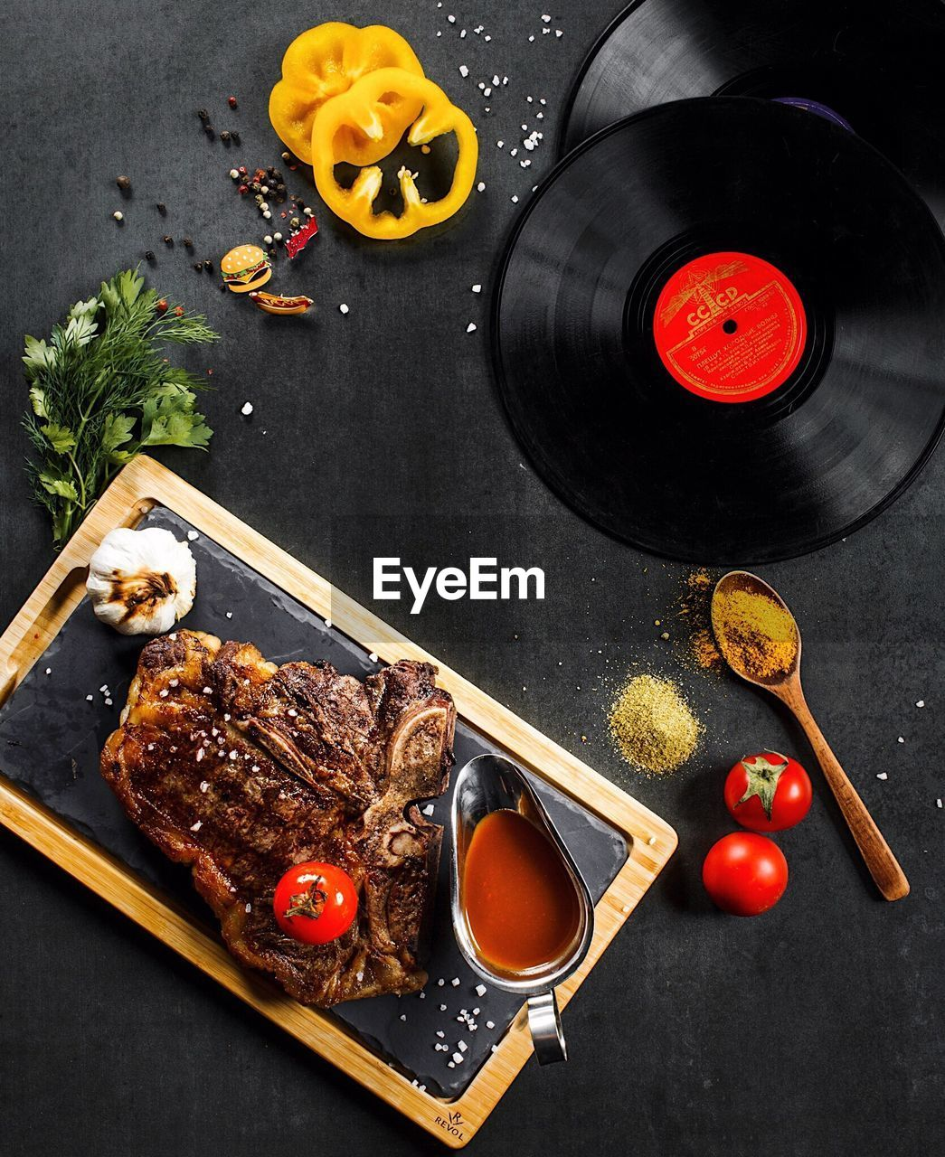 food and drink, food, freshness, high angle view, directly above, table, indoors, still life, healthy eating, vegetable, spice, plate, meat, ready-to-eat, fruit, no people, ingredient, wellbeing, pepper, sauce, herb, preparing food, black background