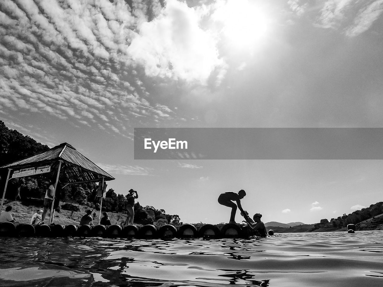 water, sky, cloud - sky, real people, nature, sea, lifestyles, waterfront, leisure activity, men, day, beauty in nature, scenics - nature, beach, rock, rock - object, outdoors