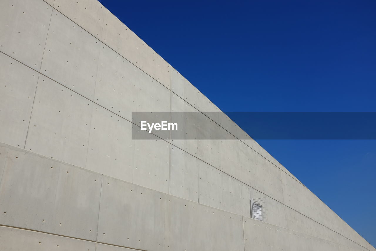 low angle view, blue, built structure, architecture, clear sky, outdoors, day, no people, building exterior