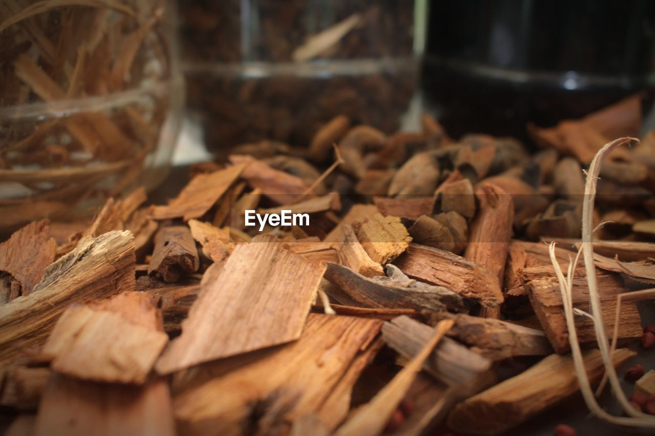 CLOSE-UP OF DRIED FOOD ON WOODEN TABLE