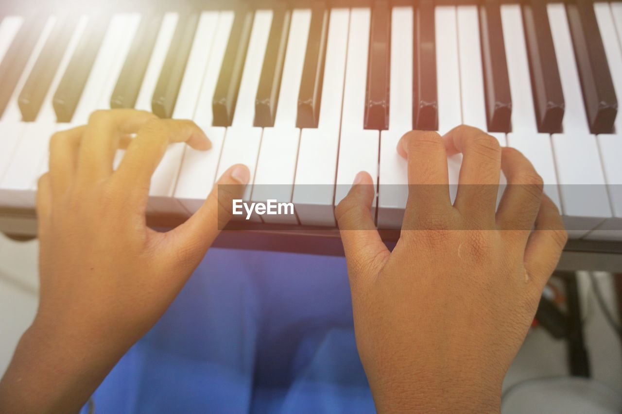 human hand, hand, human body part, music, real people, one person, piano, musical instrument, musical equipment, playing, arts culture and entertainment, body part, indoors, finger, lifestyles, human finger, piano key, close-up, leisure activity, skill, keyboard