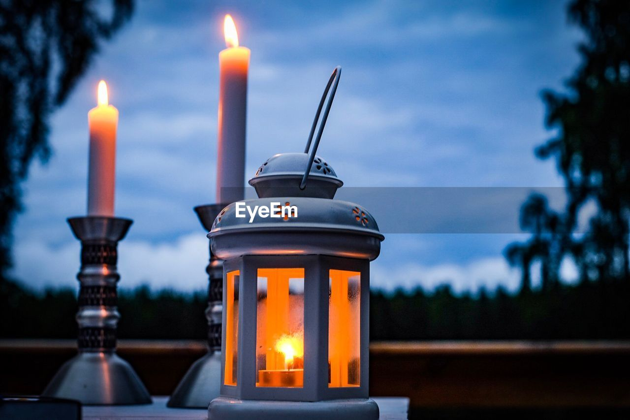 burning, fire, flame, candle, fire - natural phenomenon, illuminated, heat - temperature, focus on foreground, nature, close-up, no people, lighting equipment, lantern, built structure, dusk, architecture, candlestick holder, glowing, selective focus, outdoors, electric lamp
