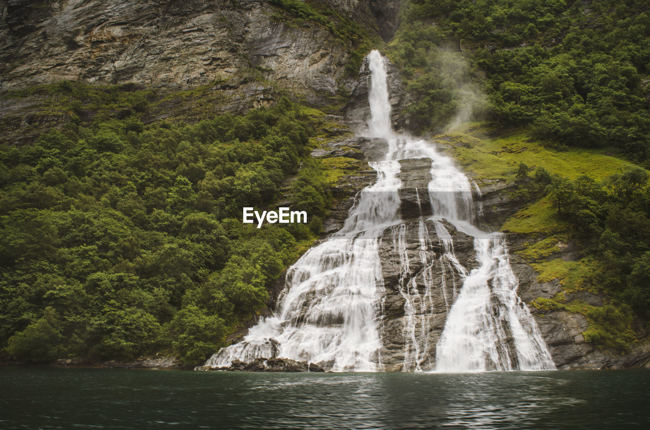 water, waterfall, land, scenics - nature, beauty in nature, rock, rock - object, forest, environment, solid, nature, motion, tree, plant, no people, long exposure, sea, flowing water, travel destinations, outdoors, power in nature, rainforest, flowing, formation