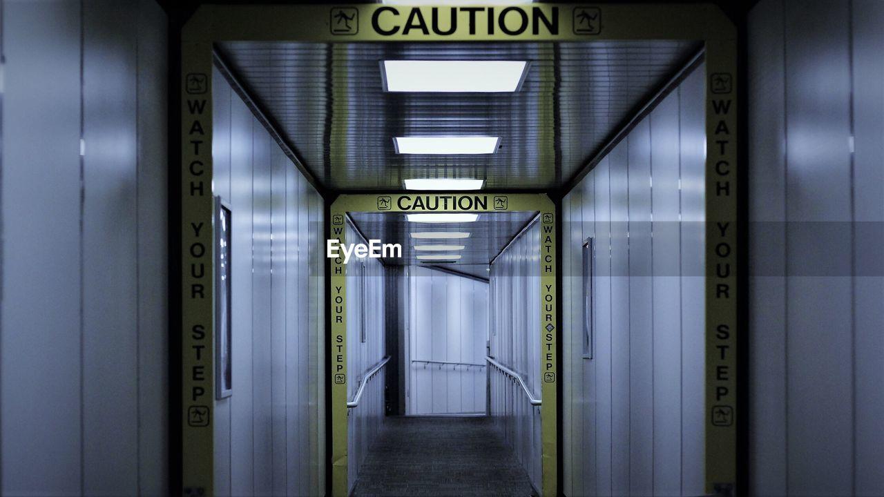 Empty Corridor With Cordon Tape