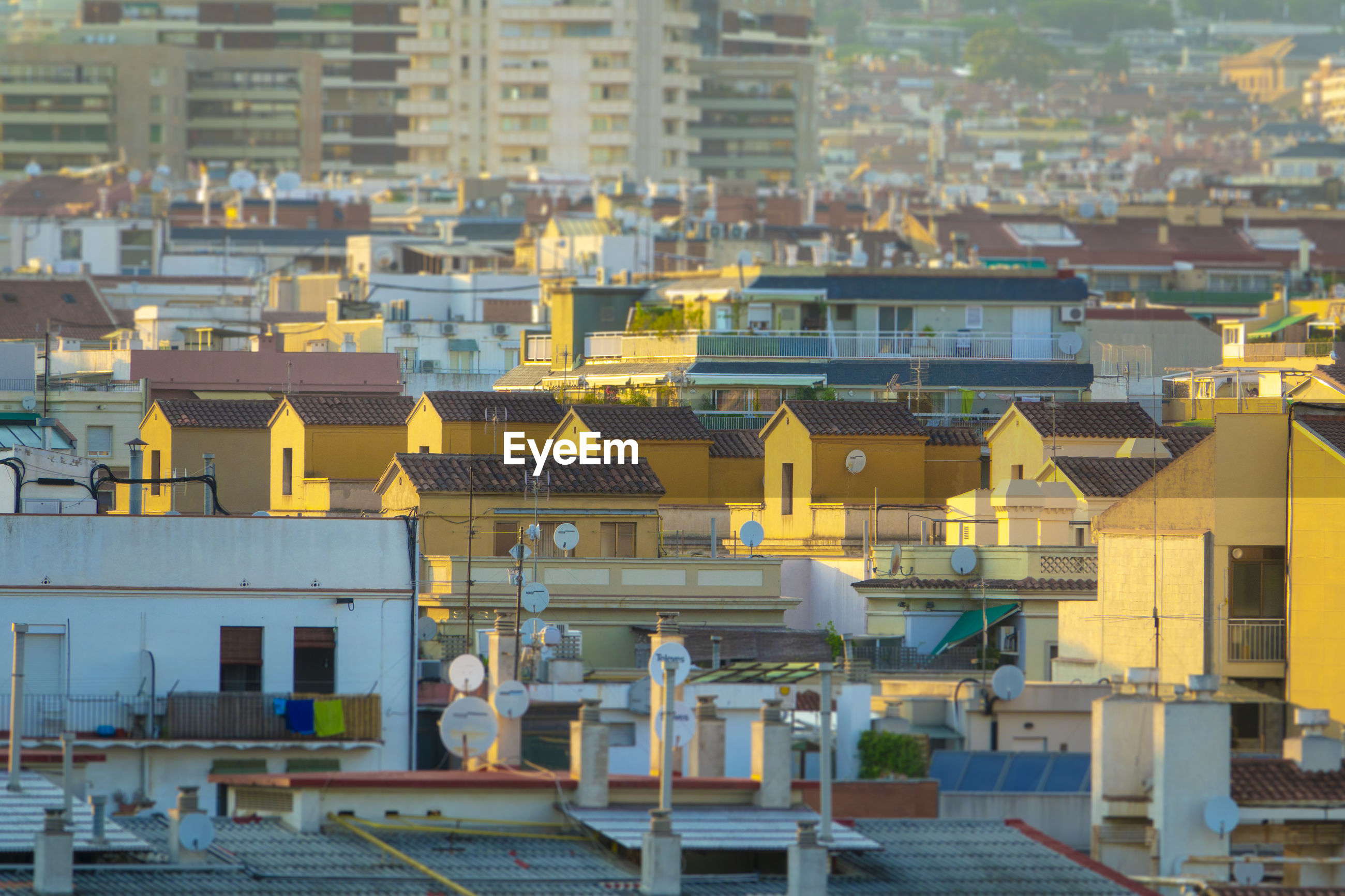 HIGH ANGLE VIEW OF YELLOW BUILDINGS IN CITY