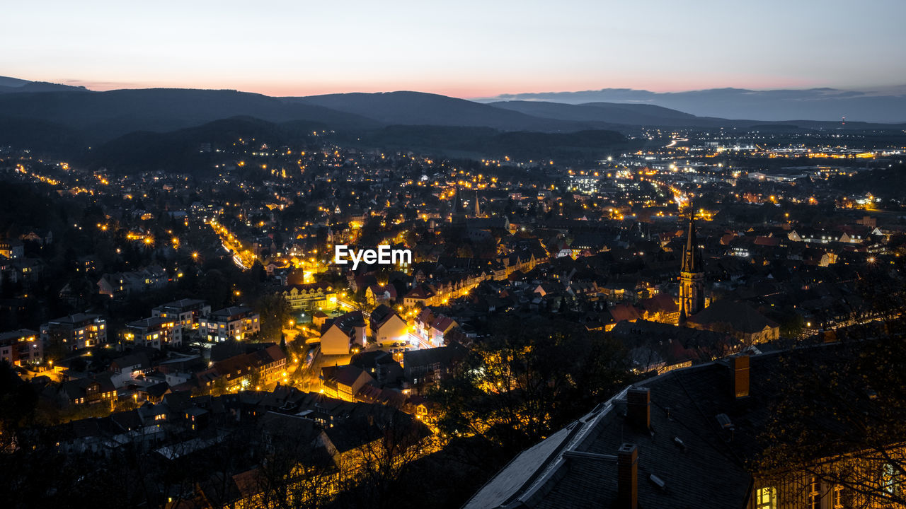 High Angle View Of Illuminated City Against Sky At Sunset