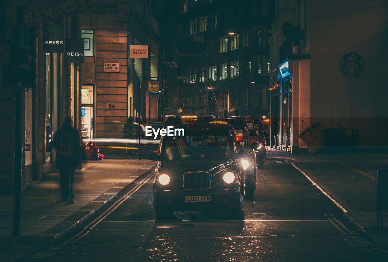 architecture, transportation, night, car, built structure, building exterior, city, illuminated, men, outdoors, people