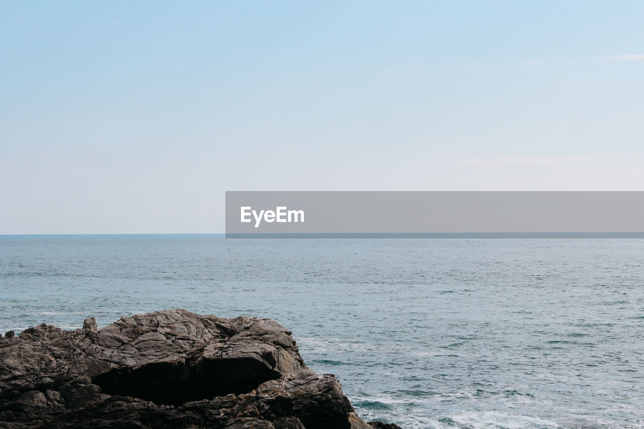 sea, horizon, water, horizon over water, sky, scenics - nature, beauty in nature, rock, rock - object, tranquility, tranquil scene, solid, nature, copy space, day, no people, non-urban scene, clear sky, idyllic, outdoors, rocky coastline