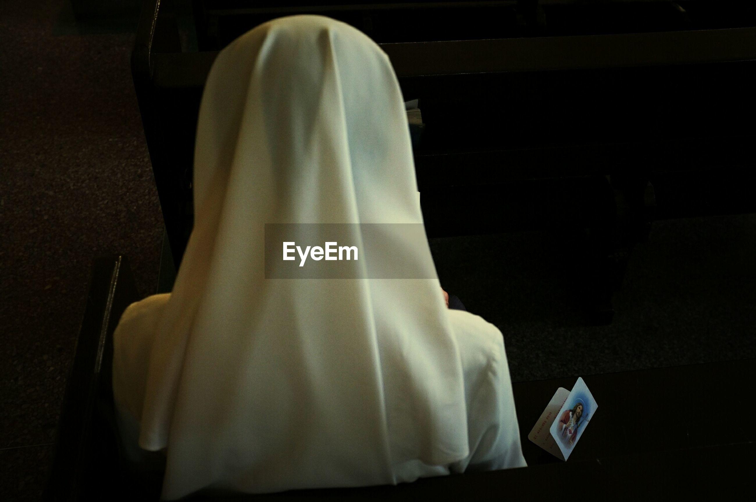 Rear view of nun in church