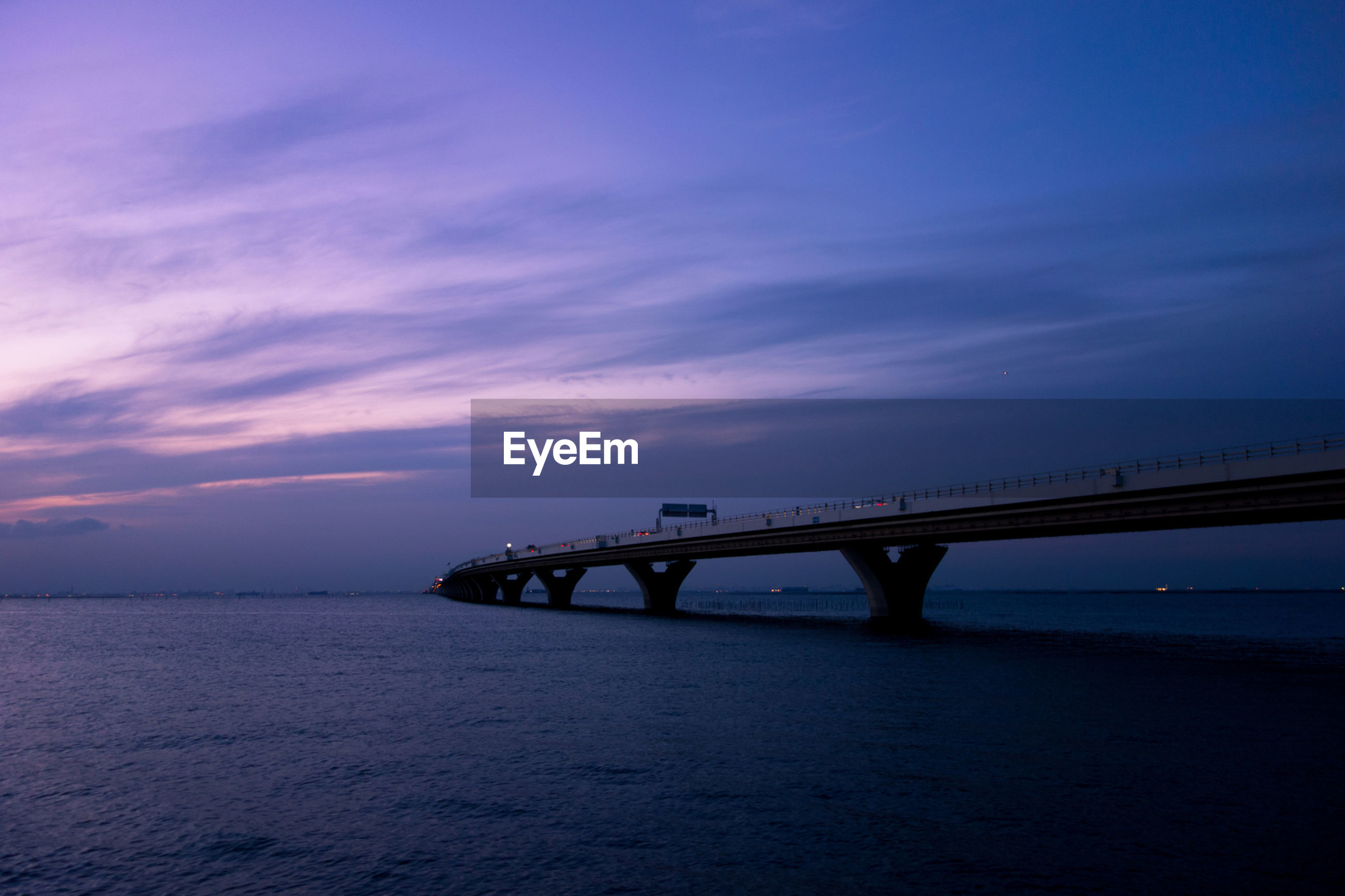 sea, water, sky, sunset, connection, tranquil scene, tranquility, scenics, bridge - man made structure, silhouette, built structure, horizon over water, cloud - sky, beauty in nature, nature, beach, dusk, architecture, cloud, bridge