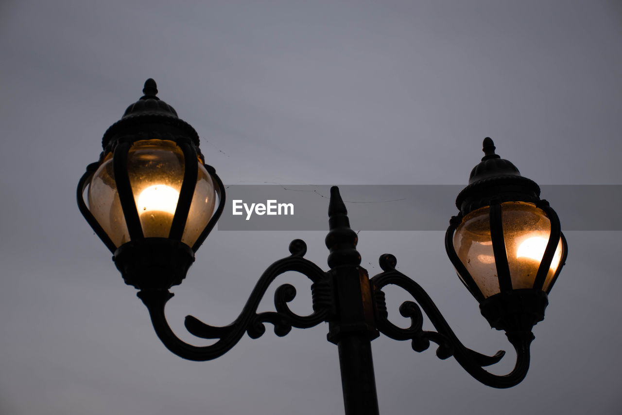 lighting equipment, illuminated, street light, low angle view, electricity, sky, dusk, street, metal, glowing, no people, electric light, nature, outdoors, light, light - natural phenomenon, lantern, gas light, retro styled, antique, ornate, electric lamp, wrought iron, electrical equipment