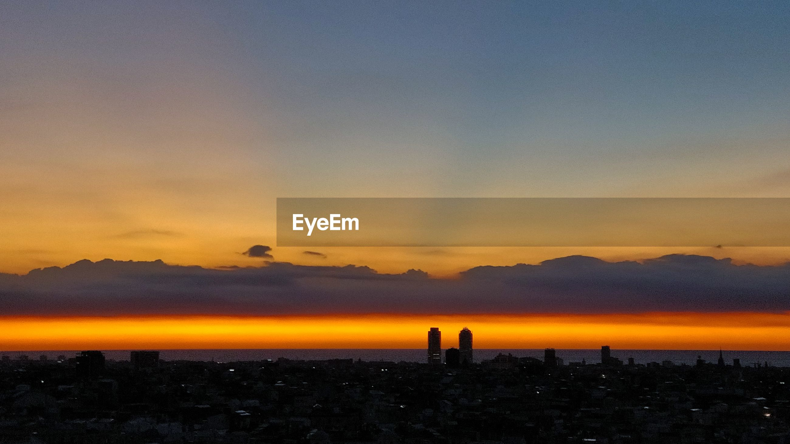 SCENIC VIEW OF SILHOUETTE BUILDINGS AGAINST ROMANTIC SKY AT SUNSET