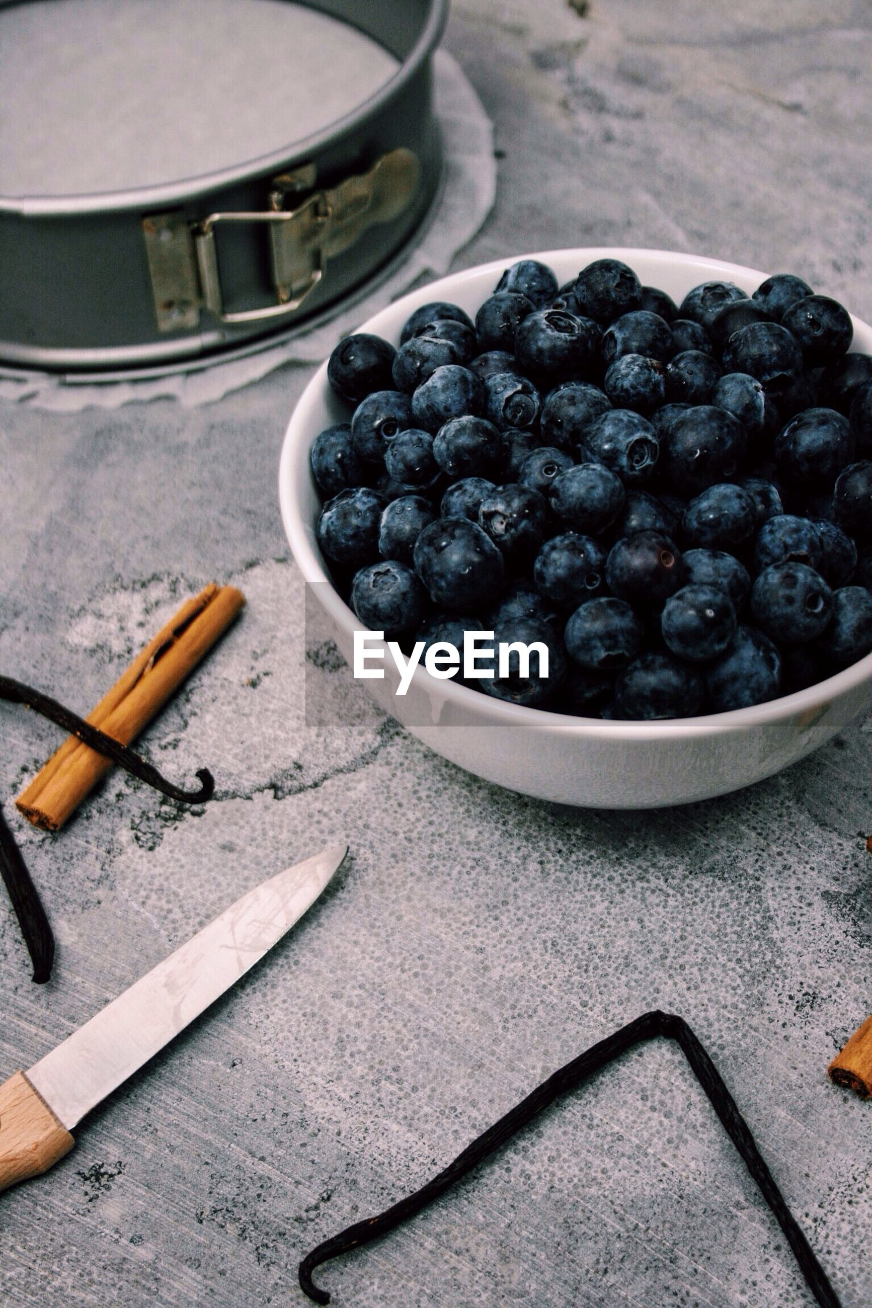 High angle view of blueberries in bowl on table