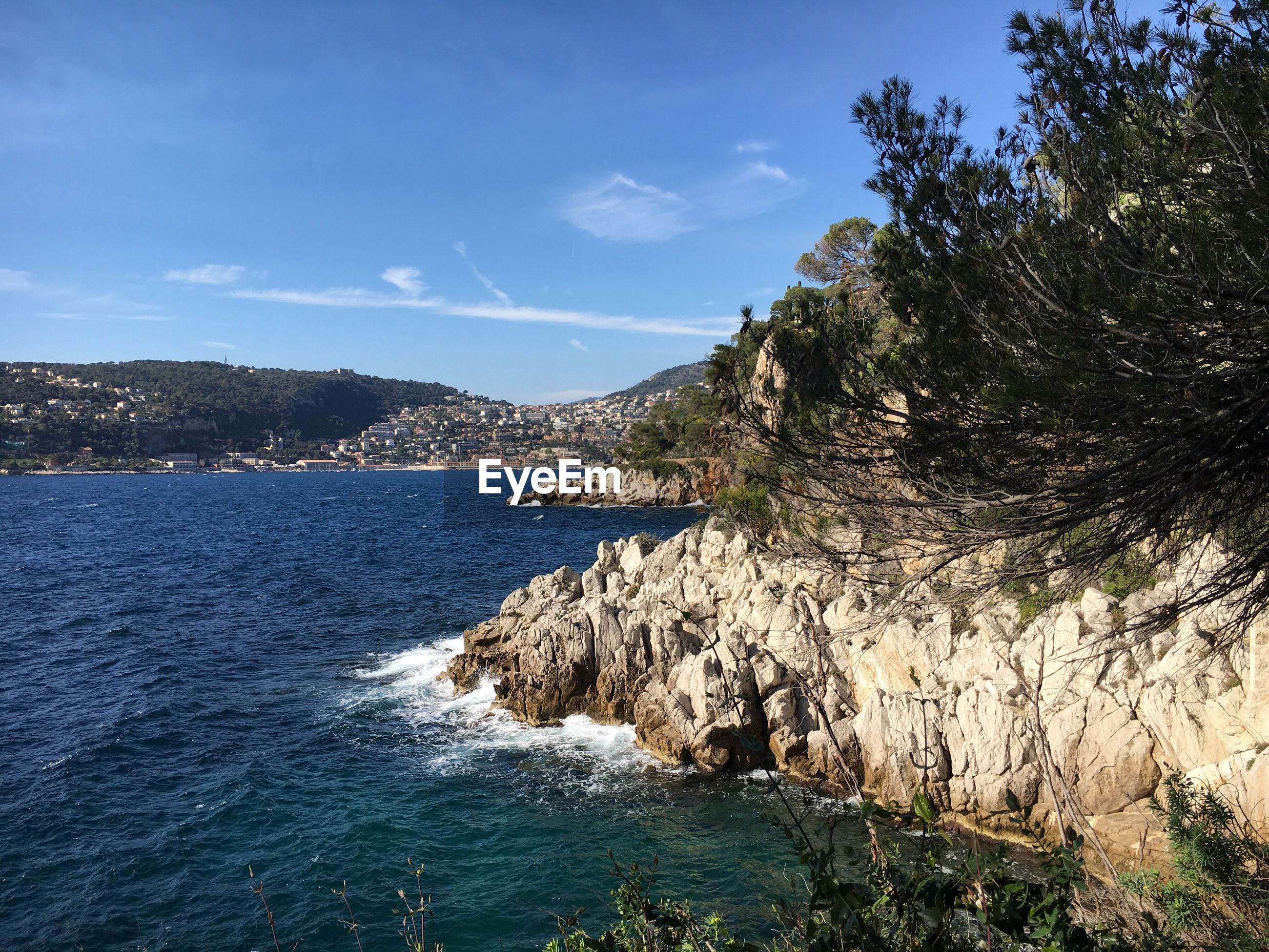 SCENIC VIEW OF SEA AND ROCK AGAINST SKY