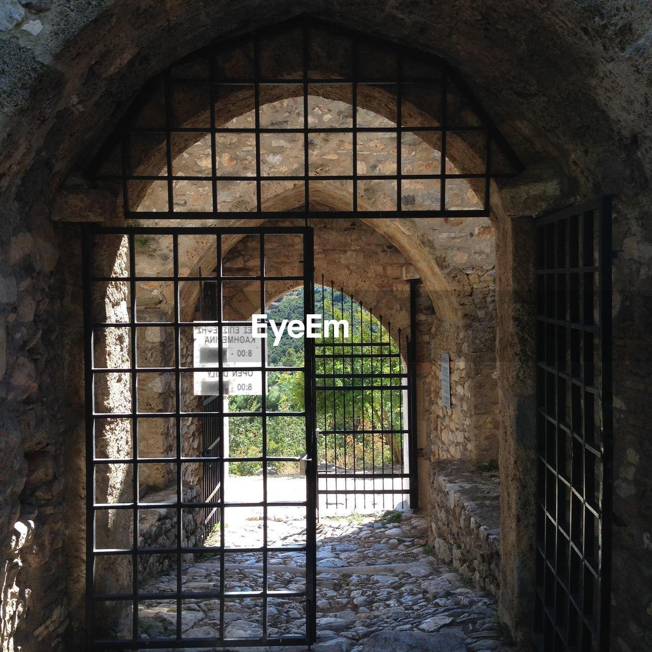 architecture, built structure, arch, window, entrance, old, door, no people, day, building, gate, history, the past, wall, metal, abandoned, indoors, open, security, stone wall, iron - metal