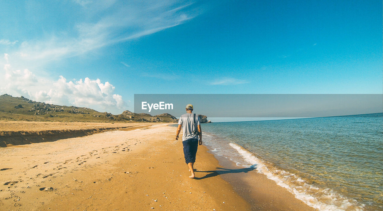 Man walks on the beach
