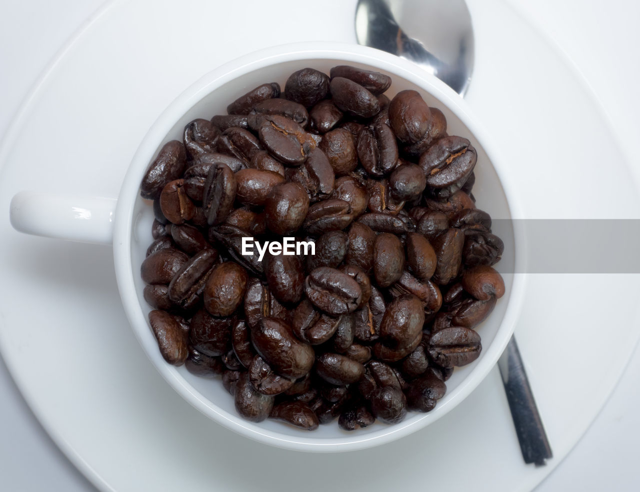 food and drink, food, freshness, indoors, coffee, still life, close-up, coffee - drink, roasted coffee bean, bowl, cup, brown, refreshment, high angle view, coffee cup, white color, no people, drink, table, directly above, crockery, temptation