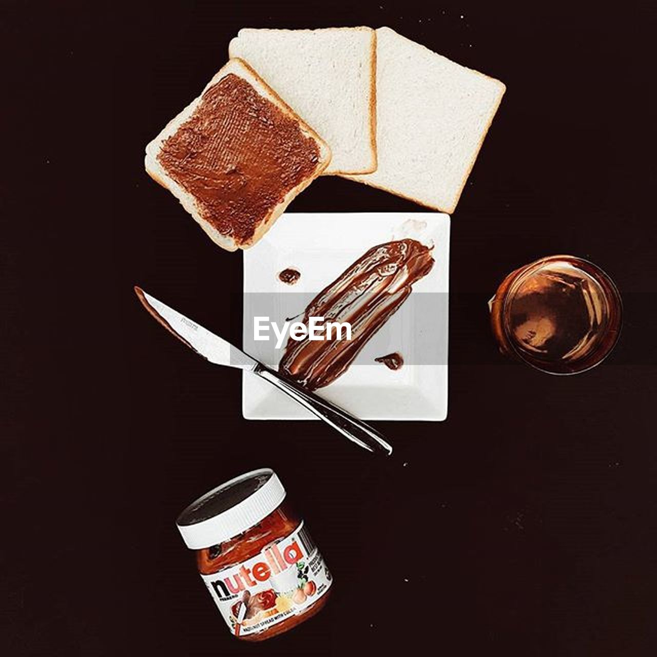 food, food and drink, indulgence, high angle view, black background, table, sweet food, no people, plate, indoors, directly above, freshness, drink, toasted bread, ready-to-eat, close-up, day