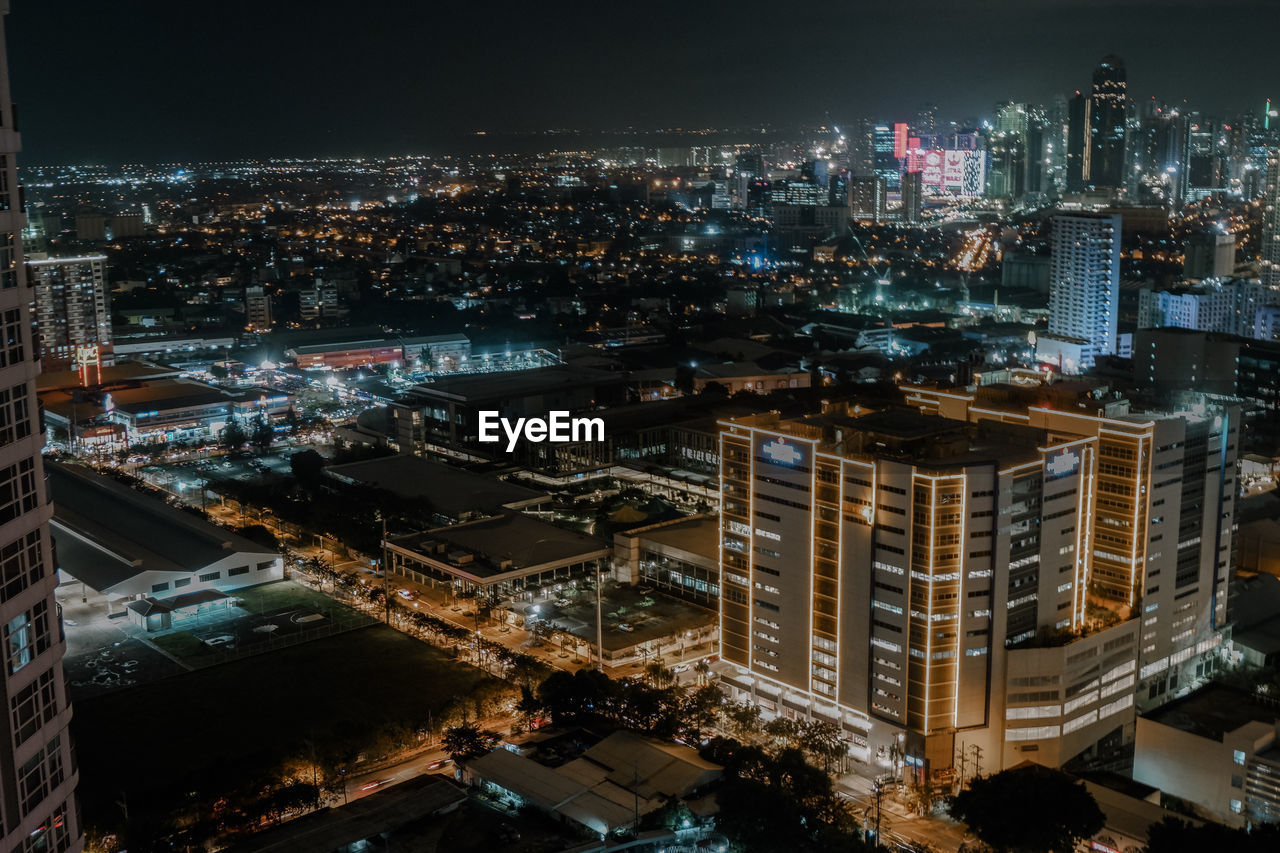building exterior, built structure, city, architecture, cityscape, building, night, illuminated, residential district, high angle view, office building exterior, crowd, modern, city life, crowded, skyscraper, sky, nature, outdoors, financial district, apartment