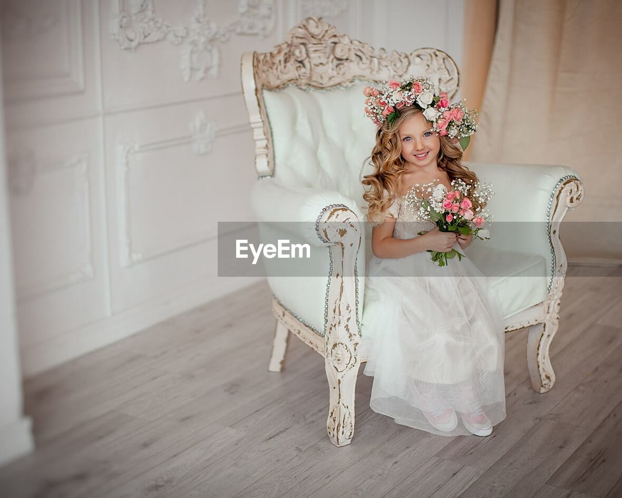 cute, indoors, one person, tiara, girls, childhood, crown, celebration, elementary age, smiling, home interior, full length, bride, portrait, wedding, happiness, sitting, beauty, children only, child, one girl only, life events, wedding dress, beautiful people, evening gown, blond hair, flower, day, people
