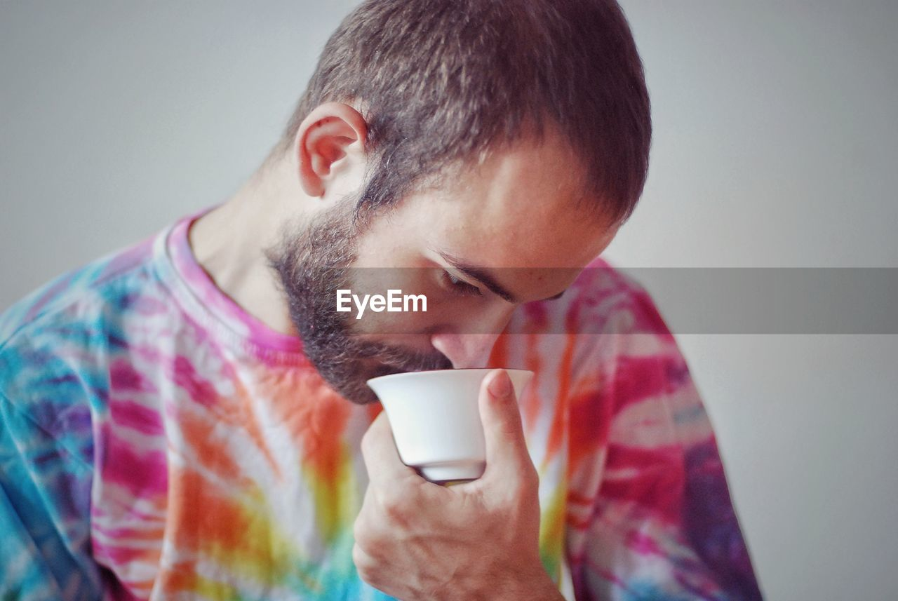 drink, mug, coffee, one person, coffee cup, coffee - drink, cup, refreshment, headshot, food and drink, drinking, lifestyles, men, young men, indoors, beard, leisure activity, holding, portrait, contemplation