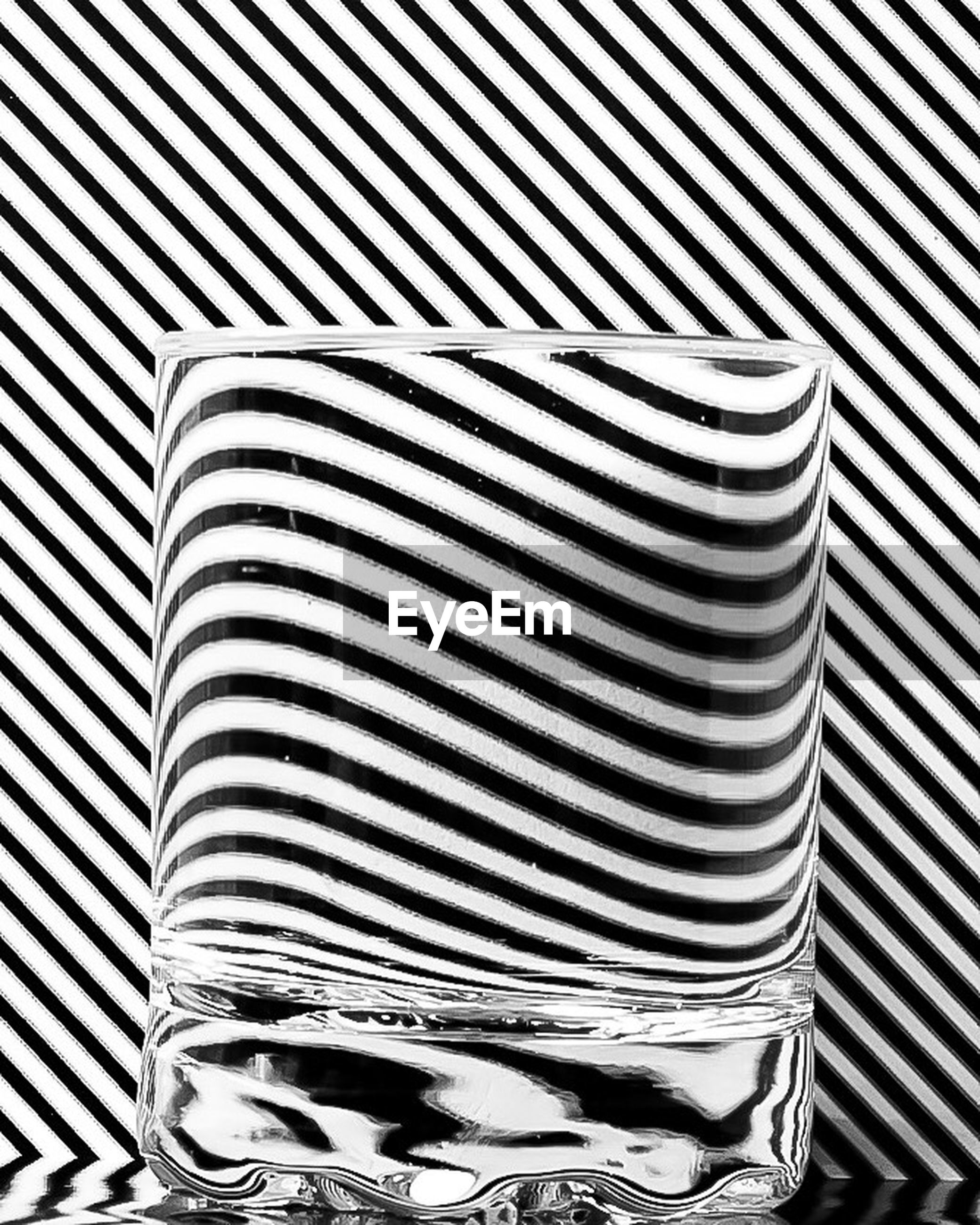 indoors, pattern, striped, low section, high angle view, standing, white color, wall - building feature, person, textile, shoe, close-up, day, design, fabric, casual clothing, lifestyles