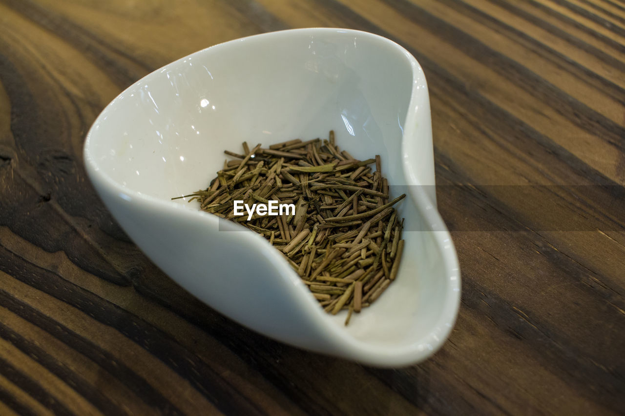 Close-up of tea leaves in container on table