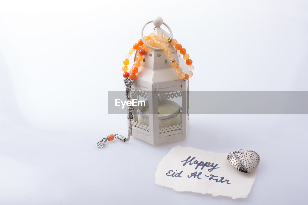 text, still life, indoors, no people, close-up, western script, communication, food, studio shot, food and drink, white background, container, copy space, freshness, sweet food, event, celebration, sweet, emotion, art and craft